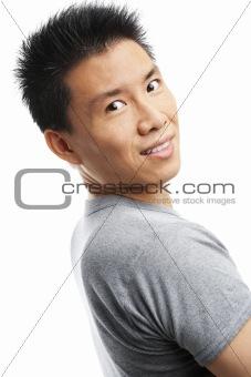 Asian young man looking at camera