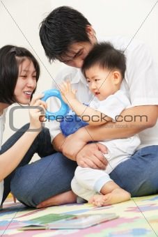 Asian young family spending time together