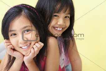 Sisters posing to camera together