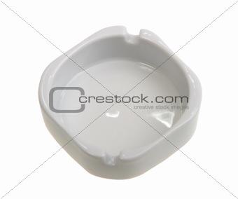 Single white ashtray is empty.