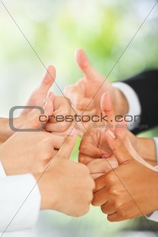 Thumbs up over green background