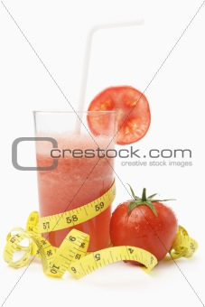 Tomato juice with measuring tape