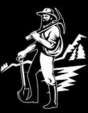 Coal miner with pick axe standing