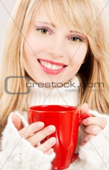 happy teenage girl with red mug