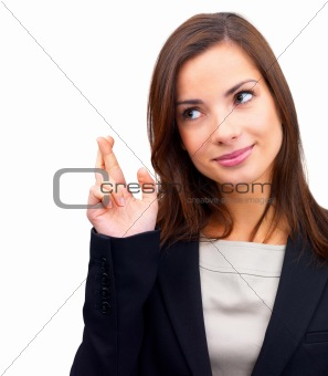 Cute business woman gesturing a luck sign on white
