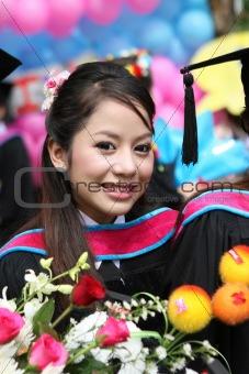 Beautiful Asian university graduate.