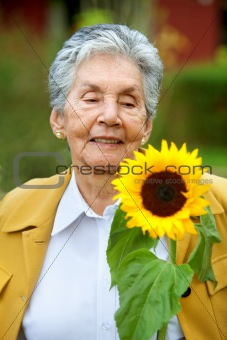 Senior woman with a sunflower