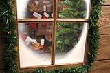Looking Thru window at Santa Taking Cookie