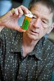 Man examining prescription bottle