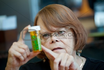 Senior Woman at Home with Prescription