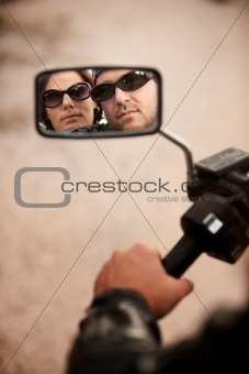 Motorcyclist and Woman Reflection