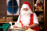 Santa Claus in Workshop With Bag of Letters