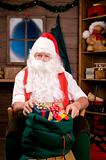 Santa Claus in Workshop With Bag of Toys
