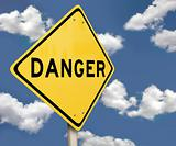 Yellow Warning Sign - Danger - Blue Sky