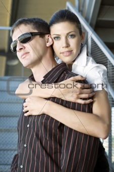 Beautiful young woman embracing her handsome boyfiend