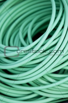 Close up on a green garden hose