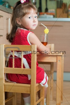a little girl at a table