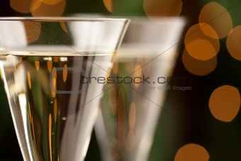 Champagne Glasses Abstract with Sparkling Lights in the Background.