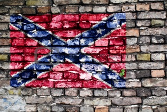 Flag of the Confederate Army painted on an old brick wall