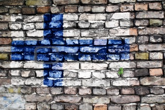 Flag of Finland painted on an old brick wall