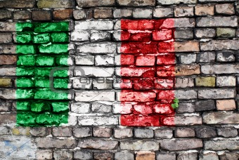 Flag of Italy painted on an old brick wall
