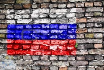 Flag of Russia painted on an old brick wall
