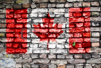 Flag of Canada painted on an old brick wall