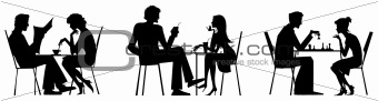 Couple silhouettes near table