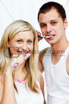 Couple cleaning their teeth