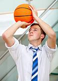 Business man throwing a basketball