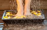 Woman moisting her feet