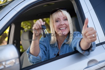 Attractive Happy Woman In New Car with Keys.