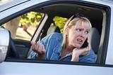 Concerned Blonde Woman Using Cell Phone While Driving.