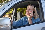 Attractive Blonde Woman Using Cell Phone While Driving.