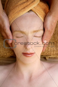 Beautiful woman portrait relaxing head massage