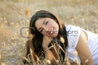 Beautiful indian brunette in a golden field