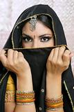 Beautiful brunette asian girl with black veil on face