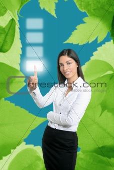 Brunette businesswoman touching virtual pad