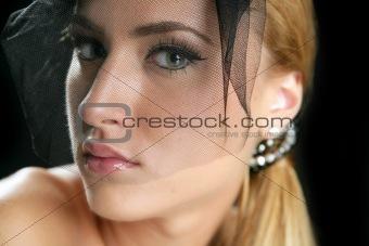 Blond fashion woman tulle veil portrait