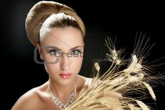 Blond fashion woman holding wheat spike