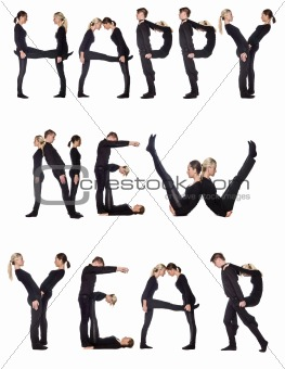 Group of people forming the phrase 'Happy new year'