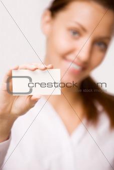 A girl holds a card