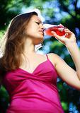 a girl drinks juice