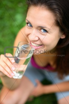 a girl drinks water