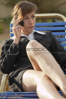 tired woman on phone