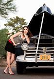 Girl in stripes with vintage car