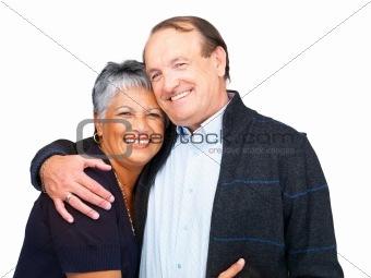 Romantic old couple embracing on white background