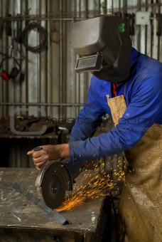 African American with angle grinder