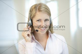 Blond businesswoman with headphone