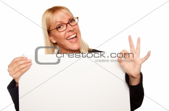 Attractive Blonde with Okay Hand Gesture Holding Blank White Sign Isolated on a White Background.